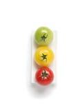 Drie kleurrijke organische tomaten Royalty-vrije Stock Afbeelding