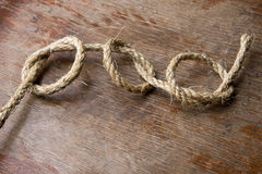 Drie knopen op oude houten raad Stock Fotografie
