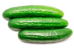 Drie komkommers geïsoleerd Royalty-vrije Stock Afbeeldingen
