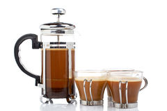 Drie koppen en koffiepot stock foto
