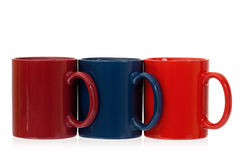 Drie koppen van de kleurenkoffie Stock Afbeeldingen