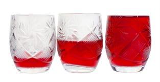 Drie kristalwijnglazen met wijn Stock Foto