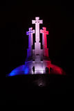 Drie Kruisenmonument in Franse nationale kleuren Stock Foto's
