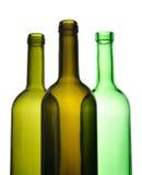 Drie lege wijnflessen voor recycling Stock Fotografie