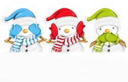 Drie leuke sneeuwmannen Stock Afbeelding