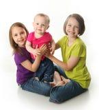 Drie leuke zusters royalty-vrije stock fotografie