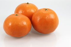 Drie mandarines met schaduwen Stock Foto