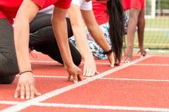 Drie meisjes bij de sprint beginnen Royalty-vrije Stock Foto