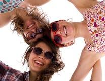 Drie meisjes die samen toetreden Royalty-vrije Stock Foto