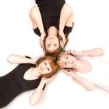 Drie meisjes in hoofdtelefoons Stock Afbeeldingen
