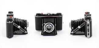 Drie meningen van Uitstekende filmcamera Stock Fotografie