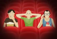 Drie mensen in een bioskoop Stock Afbeeldingen
