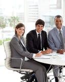 Drie mensen in het meting Stock Afbeelding