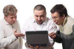Drie mensen met notitieboekje Stock Afbeeldingen