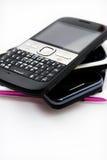 Drie mobiele telefoons Stock Foto's
