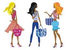 Drie mooie meisjes met zakken Stock Foto's