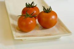 Drie mooie tomaten Stock Afbeelding