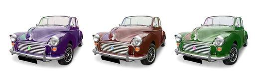 Drie Morris Minor-auto's stock foto