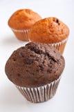 Drie muffins in een rij Stock Foto's
