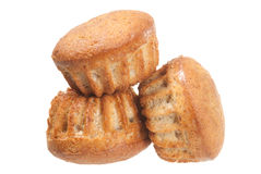Drie muffins op wit Stock Afbeeldingen