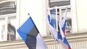 Drie natiesvlag die op de wind van de wind GH4 4K UHD golven stock videobeelden