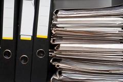 Drie omslagen en documenten Stock Foto