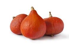 Drie oranje pompoenen Stock Foto's