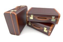 Drie oude bruine koffers Royalty-vrije Stock Afbeeldingen