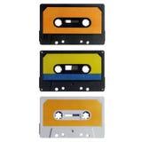 Drie oude cassettes die op wit worden geïsoleerdd Stock Foto's
