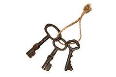 Drie oude die sleutels van de deur met kabel wordt gebonden stock foto's