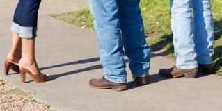 Drie paar laarzen en jeans Royalty-vrije Stock Fotografie