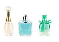 Drie parfums in flessen stock foto's
