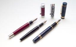 Drie pennen met kappen stock afbeeldingen