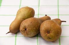 Drie peren op een droogdoek Royalty-vrije Stock Foto's