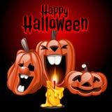 Drie pompoenen en kaarsen, Gelukkig Halloween Stock Foto's