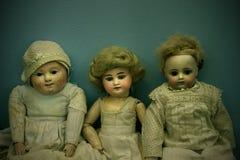 Drie poppen stock afbeelding