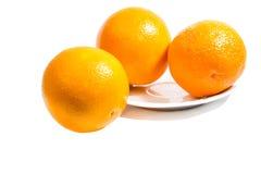 Drie rijpe sinaasappelen Royalty-vrije Stock Afbeeldingen