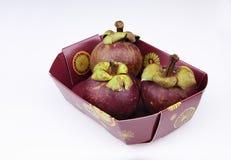 Drie rijpen mangostans Stock Foto's