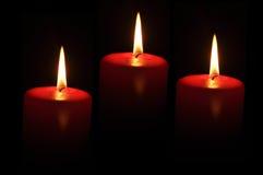 Drie rode kaarsen Stock Afbeeldingen