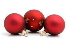 Drie rode Kerstmisballen Stock Afbeeldingen