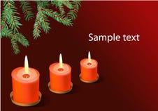 Drie rode Kerstmiskaarsen. Royalty-vrije Stock Afbeeldingen