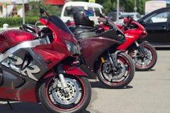 Drie rode sportenmotorfietsen Stock Afbeelding