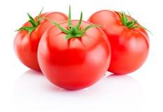 Drie rode tomaten die op witte achtergrond worden geïsoleerdl Royalty-vrije Stock Foto