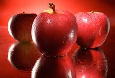 Drie rood appelenteam Stock Fotografie