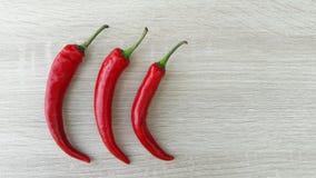 Drie roodgloeiende Spaanse peperpeper Royalty-vrije Stock Foto's
