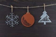 Drie Rustieke Ornamenten van Metaalkerstmis Stock Fotografie