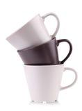 Drie samen gestapelde koffiekoppen Stock Afbeeldingen