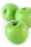 Drie sappige groene appelen royalty-vrije stock afbeelding