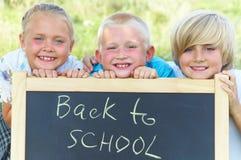 Drie schoolkinderen Stock Afbeelding