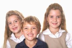 Drie schoolkinderen Stock Foto's
